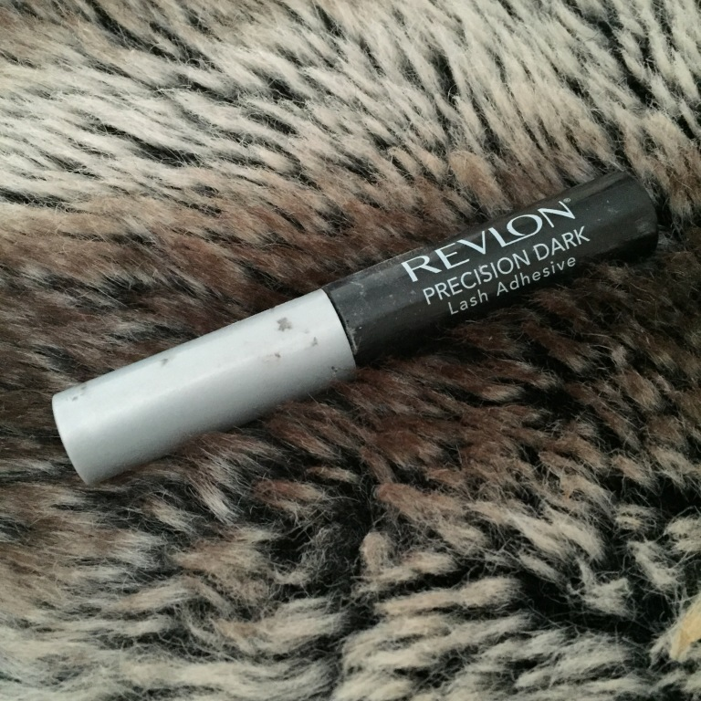 Some extremely old/dirty/ugly looking but still very effective Revlon lash glue.